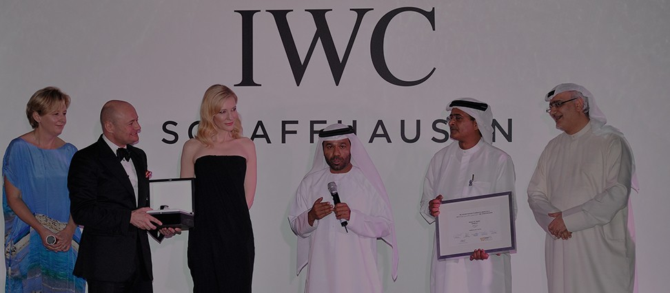 Waleed Al Shehhi speaks as he is presented with his award by Georges Kern